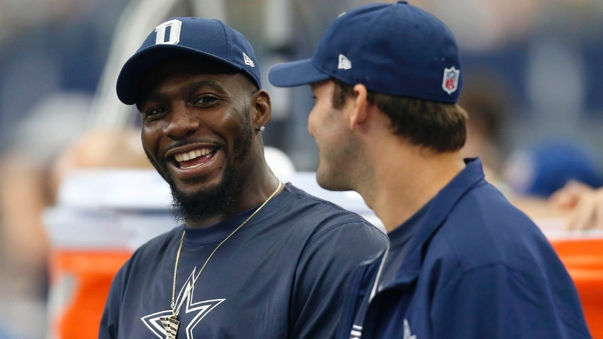 FILE - In this Sept. 27, 2015, file photo, Dallas Cowboys' Dez Bryant, left, and Tony Romo, right, talk on the sideline in the first half of an NFL football game against the Atlanta Falcons in Arlington, Texas.