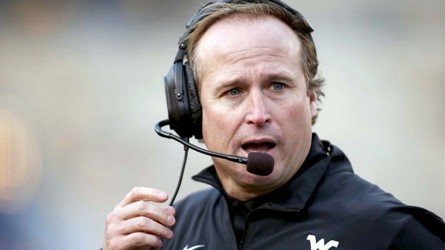 Oct 4, 2014; Morgantown, WV, USA; West Virginia Mountaineers head coach Dana Holgorsen reacts on the sidelines against the Kansas Jayhawks during the third quarter at Milan Puskar Stadium. The Mountaineers won 33-14. Mandatory Credit: Charles LeClaire-USA TODAY Sports