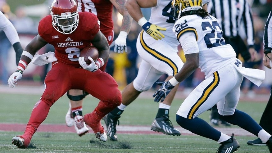 Indiana's Jordan Howard (8) runs against Michigan's Jarrod Wilson (22) during the first half of an NCAA college football game Saturday, Nov. 14, 2015, in Bloomington, Ind. (AP Photo/Darron Cummings)