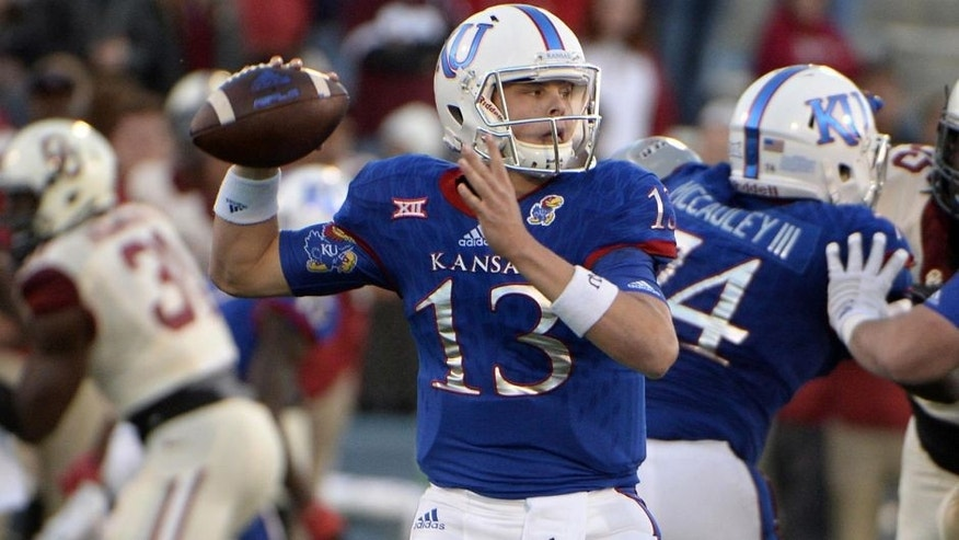 Oct 31, 2015; Lawrence, KS, USA; Kansas Jayhawks quarterback Ryan Willis (13) throws a pass against the Oklahoma Sooners in the second half at Memorial Stadium. Oklahoma won the game 62-7. Mandatory Credit: John Rieger-USA TODAY Sports