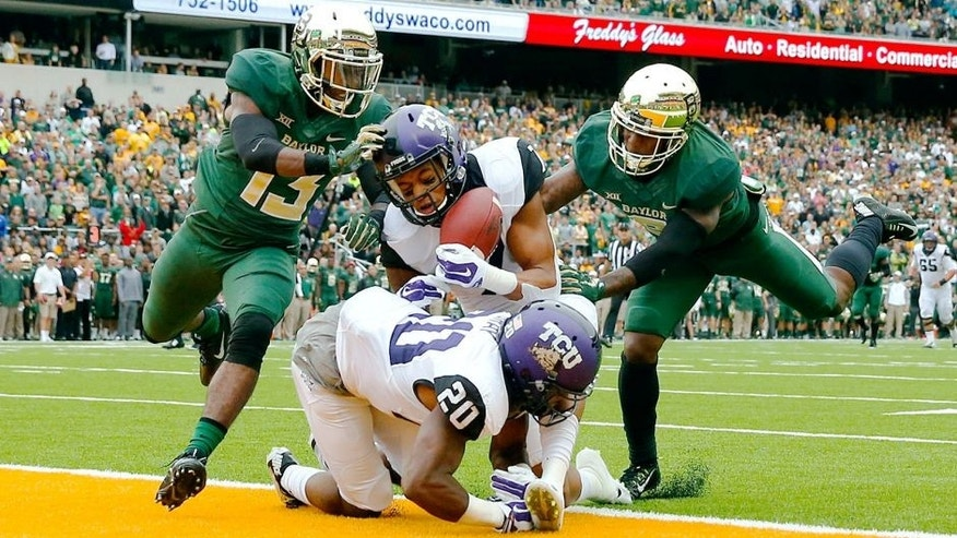 Oct 11, 2014; Waco, TX, USA; TCU Horned Frogs wide receiver Kolby Listenbee (7) catches a pass for a touchdown over Baylor Bears safety Terrell Burt (13) during the first quarter at McLane Stadium. Mandatory Credit: Kevin Jairaj-USA TODAY Sports