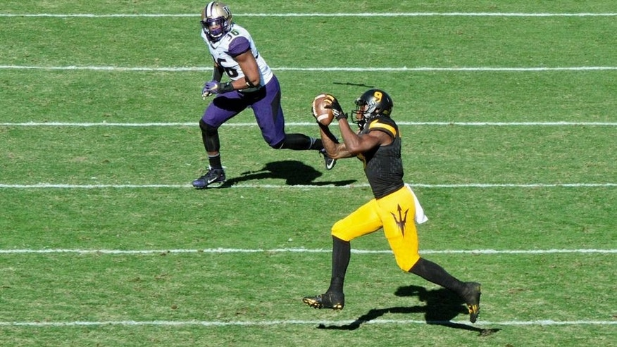 Nov 14, 2015; Tempe, AZ, USA; Arizona State Sun Devils running back Kalen Ballage (9) makes a catch as Washington Huskies linebacker Azeem Victor (36) defends during the first half at Sun Devil Stadium. Mandatory Credit: Matt Kartozian-USA TODAY Sports