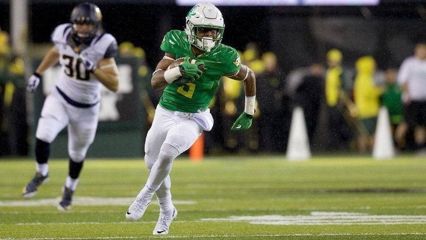 Nov 7, 2015; Eugene, OR, USA; Oregon Ducks running back Taj Griffin (5) runs the ball for a first down against the California Golden Bears at Autzen Stadium. Mandatory Credit: Scott Olmos-USA TODAY Sports