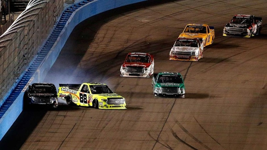 AVONDALE, AZ - NOVEMBER 13: Matt Crafton, driver of the #88 Ideal Door/Menards Toyota, hits Erik Jones, driver of the #4 Toyota Certified Used Vehicles Toyota, during the NASCAR Camping World Truck Series Lucas Oil 150 at Phoenix International Raceway on November 13, 2015 in Avondale, Arizona. (Photo by Christian Petersen/Getty Images)