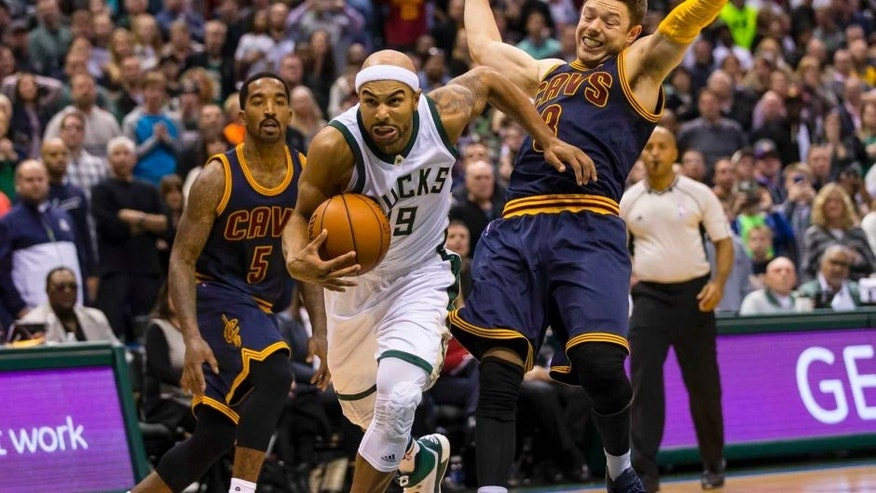 Milwaukee Bucks guard Jerryd Bayless dribbles the ball during the first overtime period against the Cleveland Cavaliers at BMO Harris Bradley Center. The Bucks won 108-105 in double overtime.