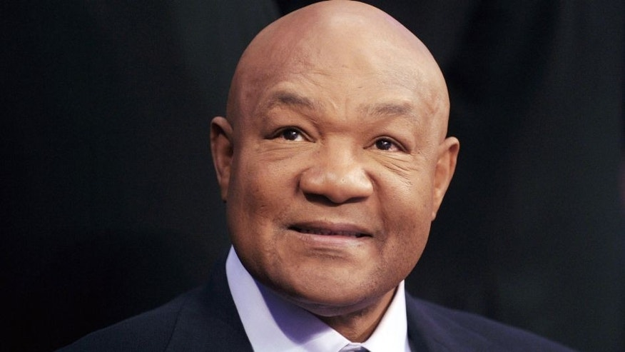 Former two-time world heavyweight champion George Foreman smiles during the 'Fists of Gold' boxing event in Macau on April 6, 2013. AFP PHOTO / Dale de la Rey (Photo credit should read DALE de la REY/AFP/Getty Images)