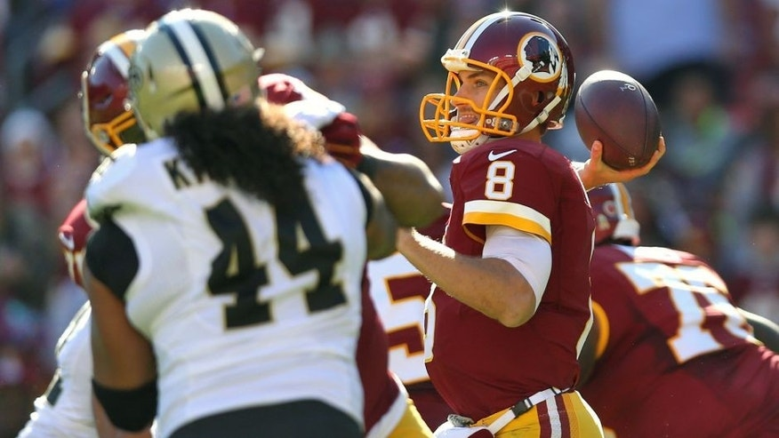 LANDOVER, MD - NOVEMBER 15: Quarterback Kirk Cousins #8 of the Washington Redskins makes a pass against the New Orleans Saints during the first half at FedExField on November 15, 2015 in Landover, Maryland. (Photo by Patrick Smith/Getty Images)