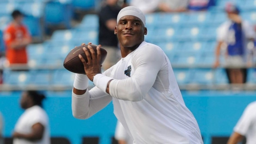 Aug 8, 2014; Charlotte, NC, USA; Carolina Panthers quarterback Cam Newton (1) warms up before the game against the Buffalo Bills at Bank of America Stadium. Mandatory Credit: Sam Sharpe-USA TODAY Sports