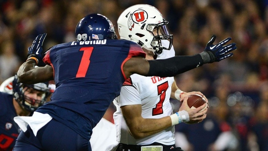 TUCSON, AZ - NOVEMBER 14: Quarterback Travis Wilson #7 of the Utah Utes is sacked by safety Tellas Jones #1 of the Arizona Wildcats in the first quarter of the game at Arizona Stadium on November 14, 2015 in Tucson, Arizona. (Photo by Jennifer Stewart/Getty Images)