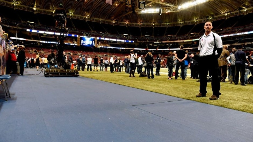 New slip resistant surface is seen just off the turf field inside the Edward Jones Dome before the start of an NFL football game between the St. Louis Rams and the Chicago Bears, Sunday, Nov. 15, 2015, in St. Louis. The surface has been added after San Francisco 49ers Reggie Bush slipped and fell during a recent game injuring himself on the uncovered, smooth surface underneath. (AP Photo/L.G. Patterson)