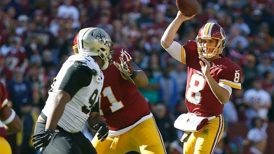 Nov 15, 2015; Landover, MD, USA; Washington Redskins quarterback Kirk Cousins (8) throws the ball over New Orleans Saints outside linebacker Kasim Edebali (91) in the first quarter at FedEx Field. Mandatory Credit: Geoff Burke-USA TODAY Sports
