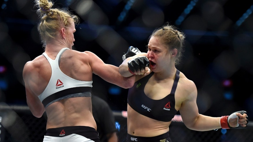 Holly Holm, left, and Ronda Rousey during their UFC 193 bantamweight title fight in Melbourne, Australia, Nov. 15, 2015.