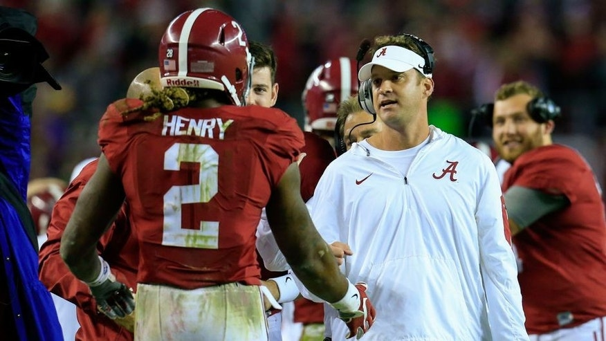 Nov 7, 2015; Tuscaloosa, AL, USA; Alabama Crimson Tide running back Derrick Henry (2) celebrates a touchdown with offensive coordinator Lane Kiffin during the third quarter against the LSU Tigers at Bryant-Denny Stadium. Mandatory Credit: Marvin Gentry-USA TODAY Sports