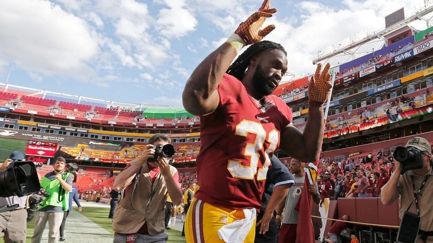 Sep 20, 2015; Landover, MD, USA; Washington Redskins running back Matt Jones (31) celebrates while leaving the field after the Redskins' game against the St. Louis Rams at FedEx Field. The Redskins won 24-10. Mandatory Credit: Geoff Burke-USA TODAY Sports