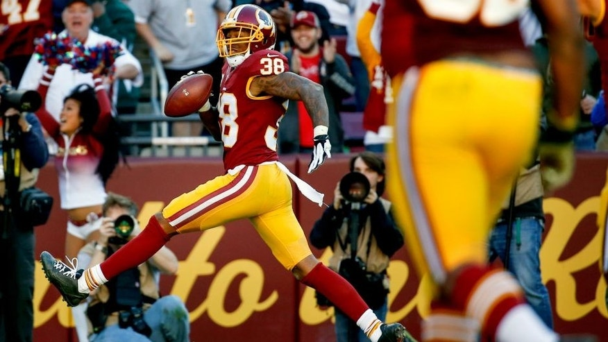 Washington Redskins free safety Dashon Goldson (38) steps into the end zone for a touchdown during the second half of an NFL football game against the New Orleans Saints in Landover, Md., Sunday, Nov. 15, 2015. (AP Photo/Alex Brandon)