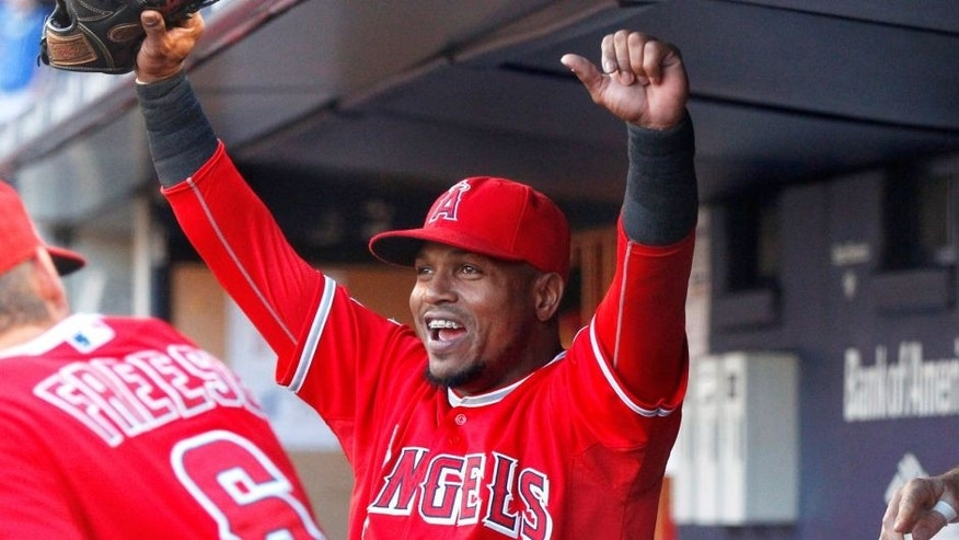 Jun 6, 2015; Bronx, NY, USA; Los Angeles Angels shortstop Erick Aybar (2) reacts in the dugout after watching the Belmont Stakes race on the giant video board prior to the game against the New York Yankees at Yankee Stadium. Mandatory Credit: Andy Marlin-USA TODAY
