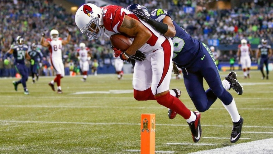 Nov 15, 2015; Seattle, WA, USA; Arizona Cardinals wide receiver Michael Floyd (15) catches a touchdown pass against Seattle Seahawks cornerback Cary Williams (26) during the second quarter at CenturyLink Field. Mandatory Credit: Joe Nicholson-USA TODAY Sports