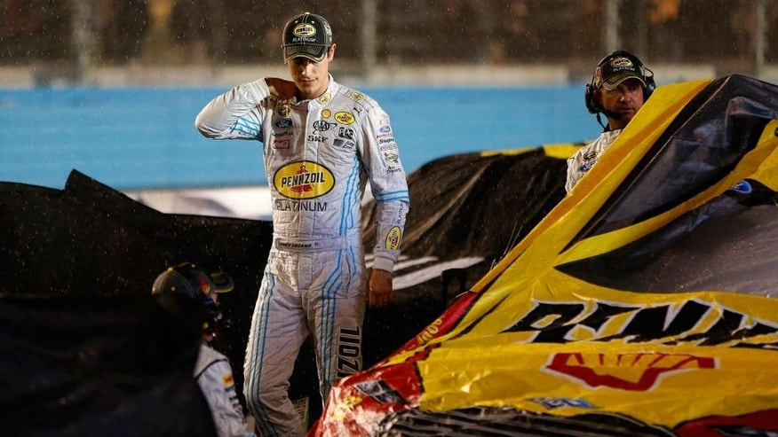 AVONDALE, AZ - NOVEMBER 15: Joey Logano, driver of the #22 Pennzoil Ford, stands on pit road during a red flag rain delay in the NASCAR Sprint Cup Series Quicken Loans Race for Heroes 500 at Phoenix International Raceway on November 15, 2015 in Avondale, Arizona. (Photo by Jonathan Ferrey/Getty Images)