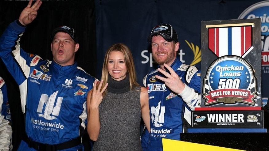 AVONDALE, AZ - NOVEMBER 15: (L-R) Amy Reimann celebrates with Dale Earnhardt Jr., driver of the #88 Nationwide Chevrolet, in victory lane after Earnhardt won the rain-shortened NASCAR Sprint Cup Series Quicken Loans Race for Heroes 500 at Phoenix International Raceway on November 15, 2015 in Avondale, Arizona. (Photo by Matt Sullivan/NASCAR via Getty Images)
