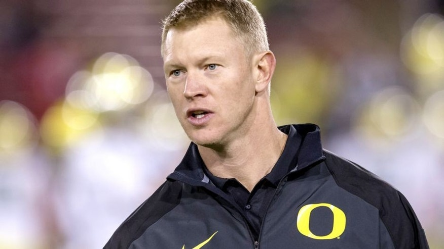 PALO ALTO, CA - NOVEMBER 7: Scott Frost, University of Oregon Offensive Coordinator, works with the Oregon Ducks team prior to a PAC-12 NCAA football game against the Stanford Cardinal played on November 7, 2013 at Stanford Stadium in Palo Alto, California. Frost played for Stanford during a portion of his own collegiate career. (Photo by David Madison/Getty Images)