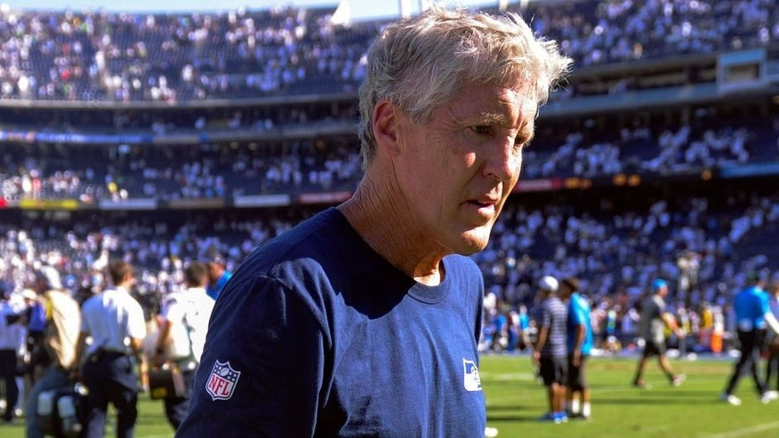 Sep 14, 2014; San Diego, CA, USA; Seattle Seahawks head coach Pete Carroll walks off the field after the Seahawks 30-21 loss to the San Diego Chargers at Qualcomm Stadium. Mandatory Credit: Robert Hanashiro-USA TODAY Sports