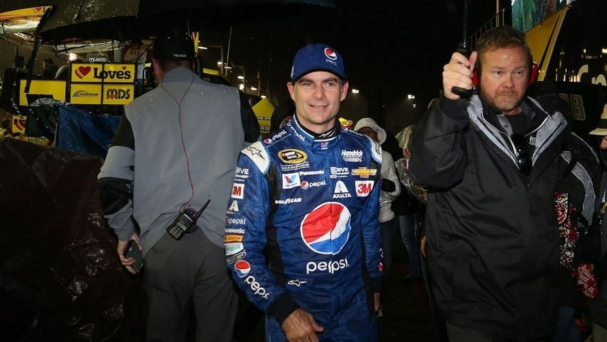 AVONDALE, AZ - NOVEMBER 15: Jeff Gordon, driver of the #24 Pepsi Chevrolet, walks off pit road in the rain during the NASCAR Sprint Cup Series Quicken Loans Race for Heroes 500 at Phoenix International Raceway on November 15, 2015 in Avondale, Arizona. (Photo by Matt Sullivan/NASCAR via Getty Images)