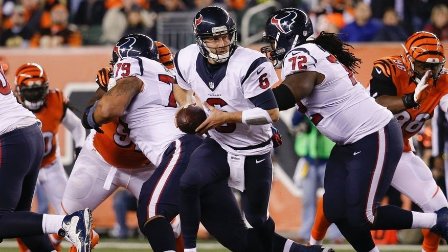 Houston Texans quarterback T.J. Yates (6) drops back to hand off in the second half of an NFL football game against the Cincinnati Bengals in Cincinnati, Monday, Nov. 16, 2015. (AP Photo/Frank Victores)