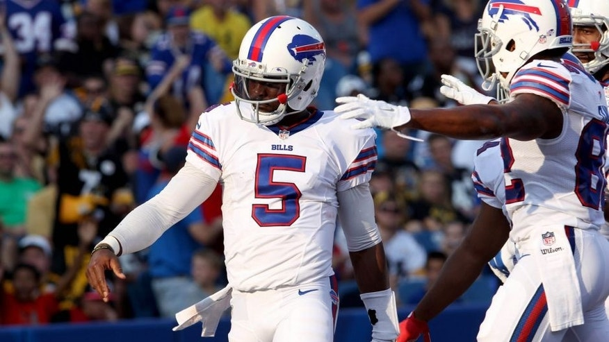 Aug 29, 2015; Orchard Park, NY, USA; Buffalo Bills quarterback Tyrod Taylor (5) celebrates his second half touchdown against the Pittsburgh Steelers at Ralph Wilson Stadium. Bills beat the Steelers 43 to 19. Mandatory Credit: Timothy T. Ludwig-USA TODAY Sports