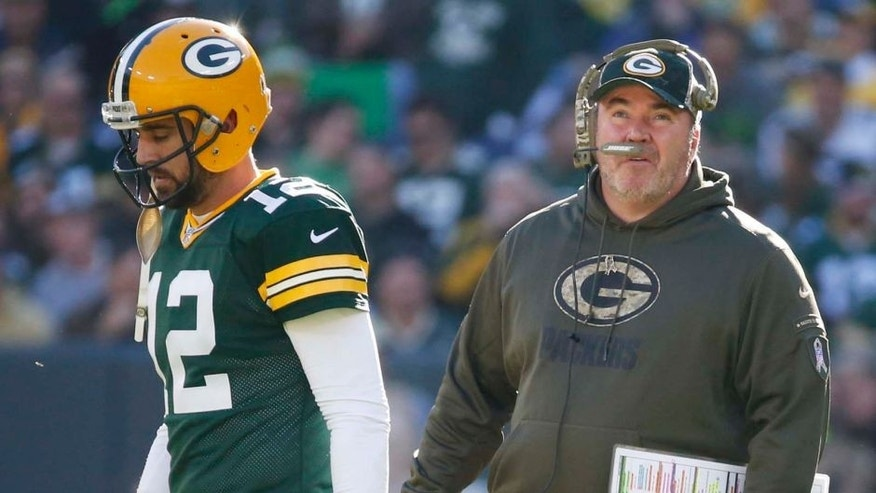 Green Bay Packers head coach Mike McCarthy talks to quarterback Aaron Rodgers during the first half of an NFL football game against the Detroit Lions on Sunday, Nov. 15, 2015, in Green Bay, Wis.