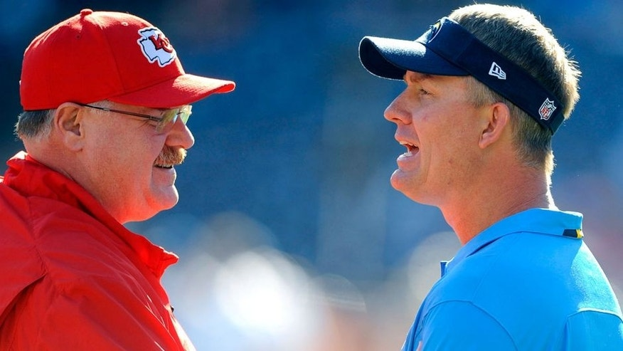 Dec 29, 2013; San Diego, CA, USA; San Diego Chargers head coach Mike McCoy (l) talks with Kansas City Chiefs head coach Andy Reid (r) prior to the game at Qualcomm Stadium. Mandatory Credit: Christopher Hanewinckel-USA TODAY Sports