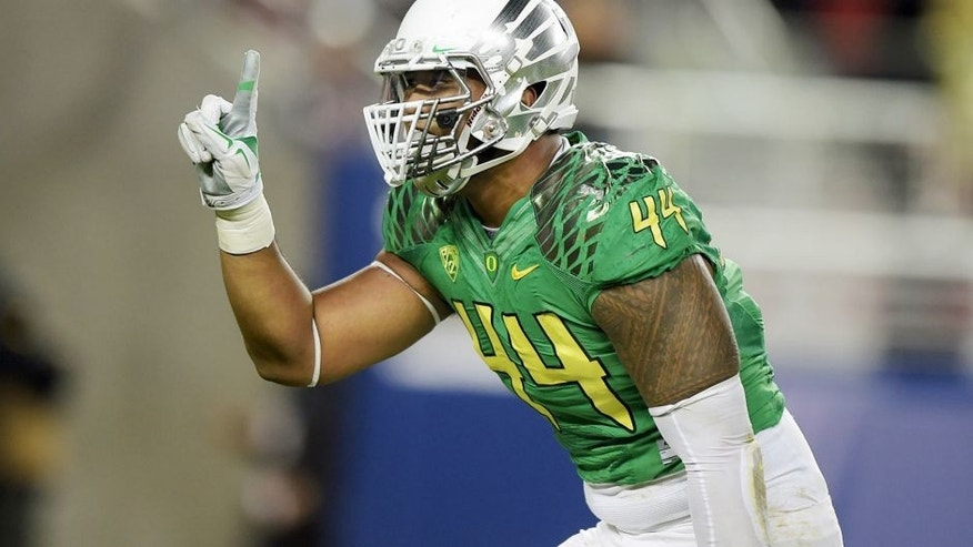 Dec 5, 2014; Santa Clara, CA, USA; Oregon Ducks defensive end DeForest Buckner (44) celebrates after a sack in the second quarter against the Arizona Wildcats in the Pac-12 Championship at Levi's Stadium. Mandatory Credit: Kirby Lee-USA TODAY Sports