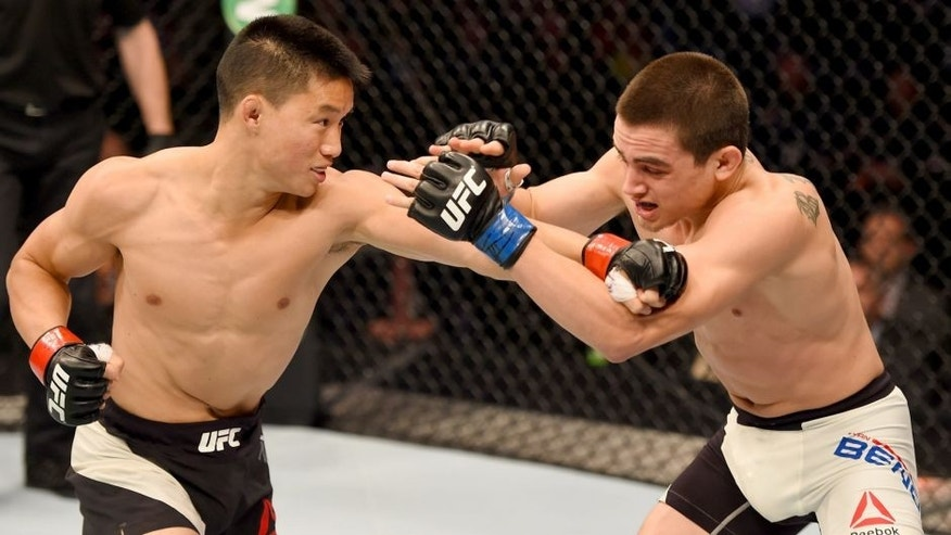 MELBOURNE, AUSTRALIA - NOVEMBER 15: (L-R) Ben Nguyen throws a punch against Ryan Benoit in the first round of their flyweight bout during the UFC 193 event at Etihad Stadium on November 15, 2015 in Melbourne, Australia. (Photo by Josh Hedges/Zuffa LLC/Zuffa LLC via Getty Images)