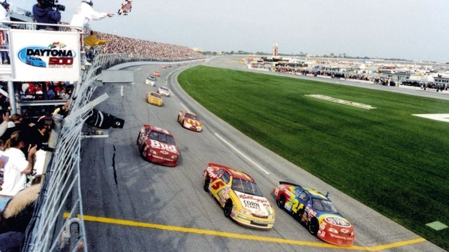 DAYTONA BEACH, FL - FEBRUARY 16, 1997: Jeff Gordon (#24) leads teammates Terry Labonte (#5) and Ricky Craven (#25) across the 1997 Daytona 500 finish line. The race finished under caution after a late race crash brought out the yellow. (Photo by ISC Archives via Getty Images)