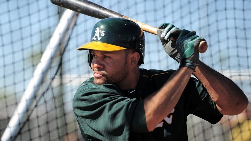 Feb 25, 2015; Mesa, AZ, USA; Oakland Athletics center fielder Coco Crisp (4) bats during a workout at Fitch Park. Mandatory Credit: Joe Camporeale-USA TODAY Sports