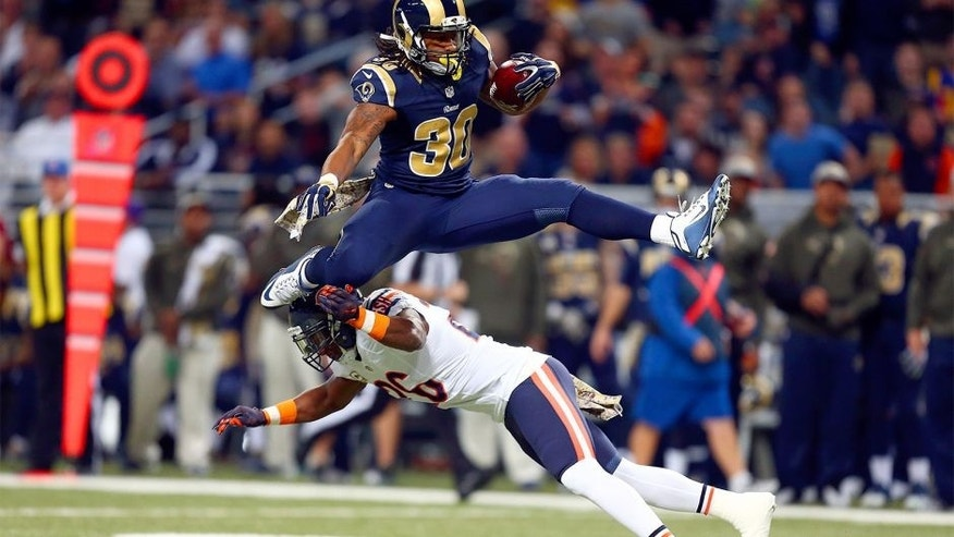 ST. LOUIS, MO - NOVEMBER 15: Todd Gurley #30 of the St. Louis Rams leaps over Antrel Rolle #26 of the Chicago Bears as he carries the ball in the first quarter at the Edward Jones Dome on November 15, 2015 in St. Louis, Missouri. (Photo by Dilip Vishwanat/Getty Images)