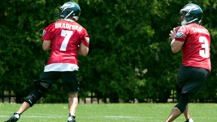 May 28, 2015; Philadelphia, PA, USA; Philadelphia Eagles quarterback Sam Bradford (7) and quarterback Mark Sanchez (3) drop back to pass during OTA's at the NovaCare Complex. Mandatory Credit: Bill Streicher-USA TODAY Sports