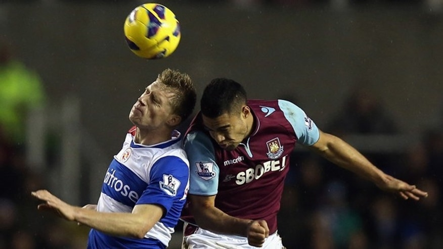 READING, ENGLAND - DECEMBER 29:  Winston Reid of West Ham United clashes off Pavel Pogrebnyak of Reading during the Barclays Premier League match between Reading and West Ham United at the Madejski Stadium on December 29, 2012 in Reading, England.  (Photo by Bryn Lennon/Getty Images)