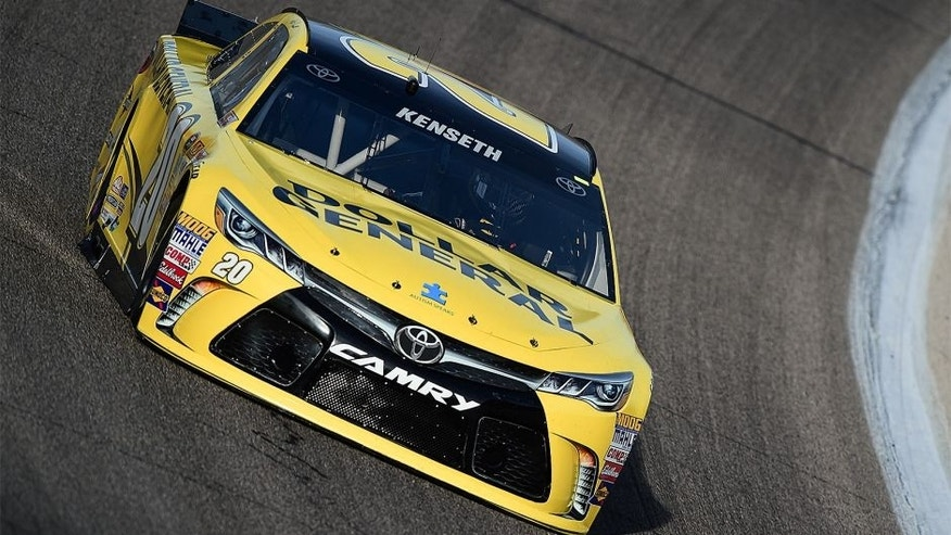 Matt Kenseth, driver of the #20 Dollar General Toyota, drives during qualifying for the NASCAR Sprint Cup Series Duck Commander 500 at Texas Motor Speedway on April 10, 2015 in Fort Worth, Texas.