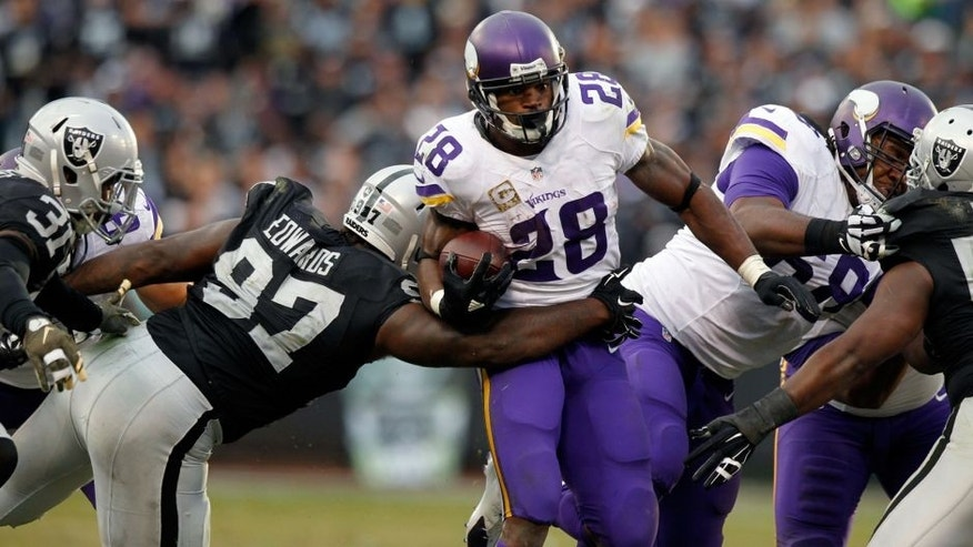 Nov 15, 2015; Oakland, CA, USA; Minnesota Vikings running back Adrian Peterson (28) runs the ball against the Oakland Raiders in the fourth quarter at O.co Coliseum. The Vikings defeated the Raiders 30-14. Mandatory Credit: Cary Edmondson-USA TODAY Sports