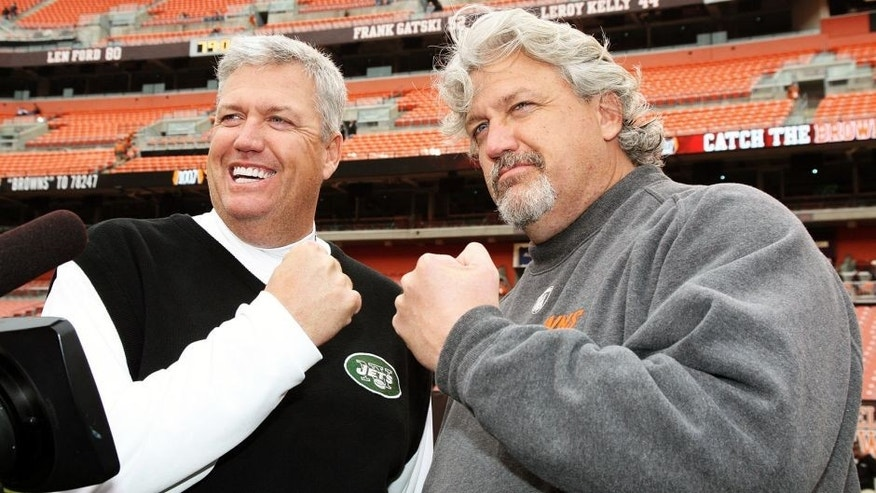 CLEVELAND - NOVEMBER 14: Head Coach Rex Ryan of the New York Jets meets with his twin brother, Defensive Coordinator Rob Ryan of the Cleveland Browns when the Cleveland Browns host the New York Jets at Cleveland Browns Stadium on November 14, 2010 in Cleveland, Ohio. Jets beat the Browns, 26-20, in Overtime. (Photo by Al Pereira/New York Jets/Getty Images) .