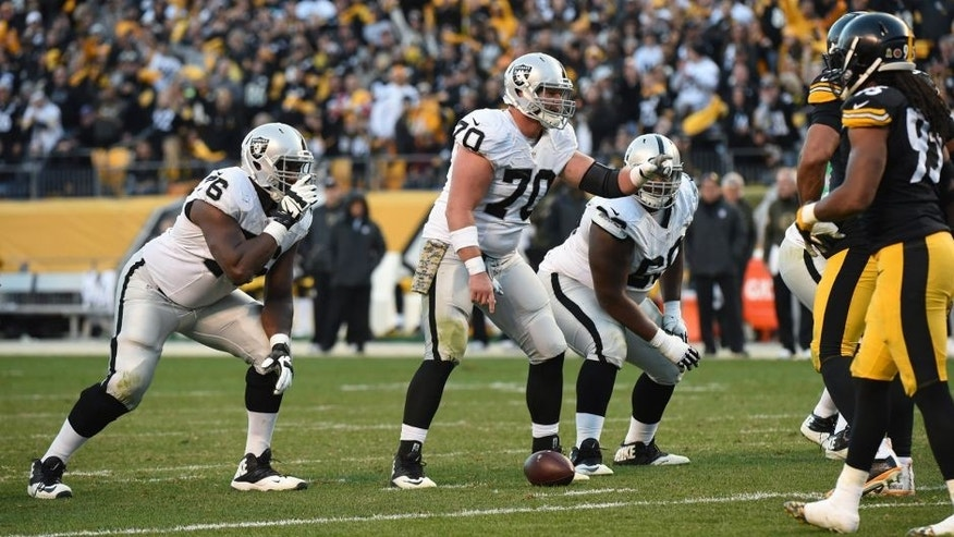PITTSBURGH, PA - NOVEMBER 8: Center Tony Bergstrom #70 of the Oakland Raiders signals at the line of scrimmage as guards J'Marcus Webb #76 and Gabe Jackson #66 look on during a game against the Pittsburgh Steelers at Heinz Field on November 8, 2015 in Pittsburgh, Pennsylvania. The Steelers defeated the Raiders 38-35. (Photo by George Gojkovich/Getty Images)