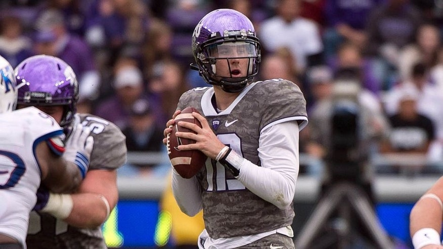 Nov 14, 2015; Fort Worth, TX, USA; TCU Horned Frogs quarterback Foster Sawyer (12) drops back to pass against the Kansas Jayhawks during the second half at Amon G. Carter Stadium. Mandatory Credit: Jerome Miron-USA TODAY Sports