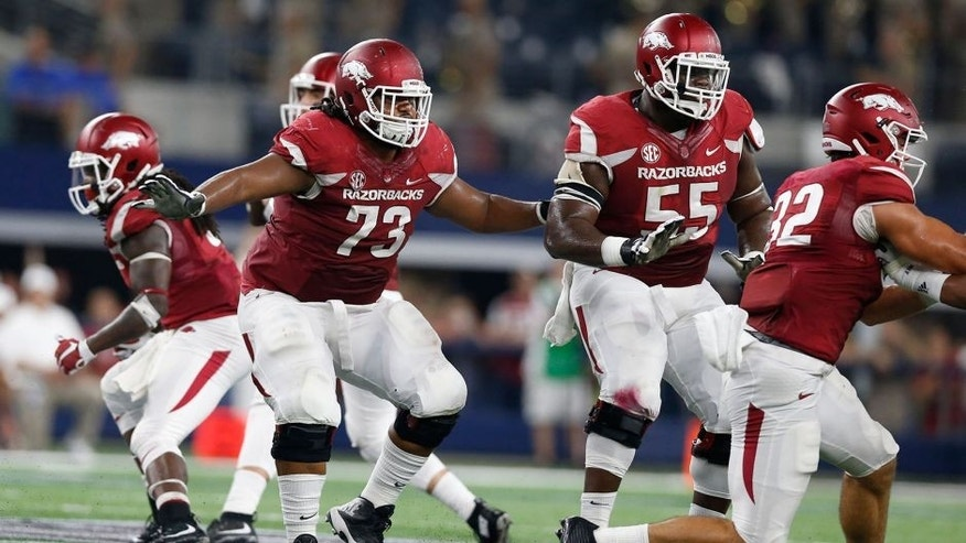 Sep 26, 2015; Arlington, TX, USA; Arkansas Razorbacks guard Sebastian Tretola (73) in action with tackle Jeremiah Levbetter (55) against the Texas A&M Aggies at AT&T Stadium. Mandatory Credit: Matthew Emmons-USA TODAY Sports