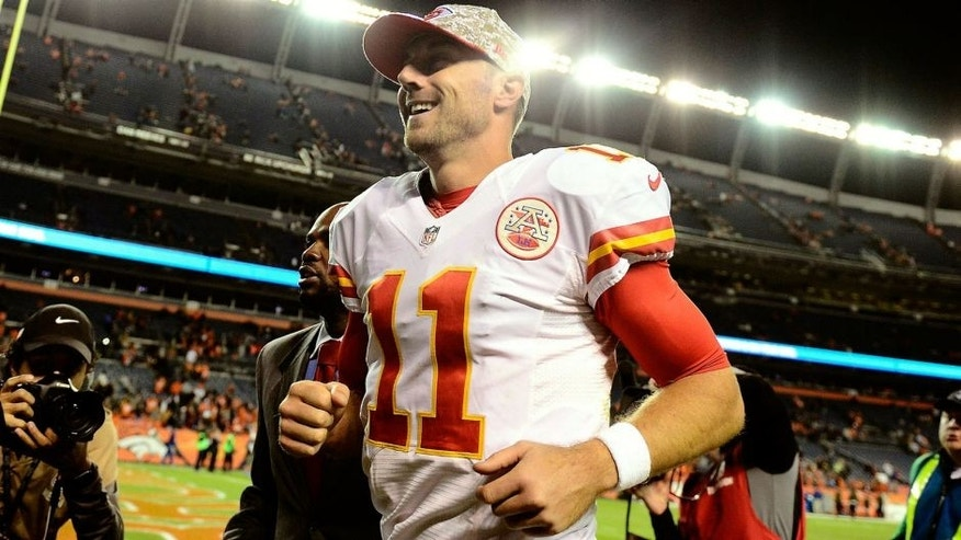 Nov 15, 2015; Denver, CO, USA; Kansas City Chiefs quarterback Alex Smith (11) celebrates the win over the Denver Broncos at Sports Authority Field at Mile High. The Chiefs defeated the Broncos 29-13. Mandatory Credit: Ron Chenoy-USA TODAY Sports