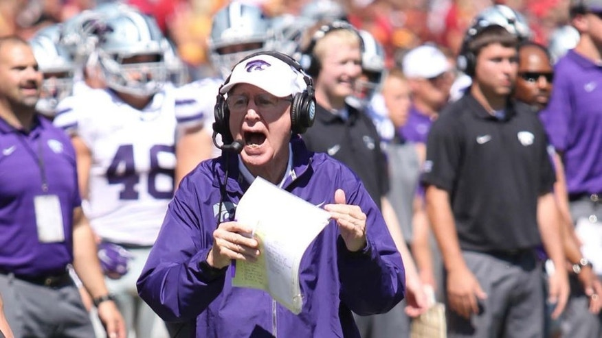 Sep 6, 2014; Ames, IA, USA; Kansas State Wildcats head coach Bill Snyder yells for a timeout against the Iowa State Cyclones at at Jack Trice Stadium. Mandatory Credit: Reese Strickland-USA TODAY Sports