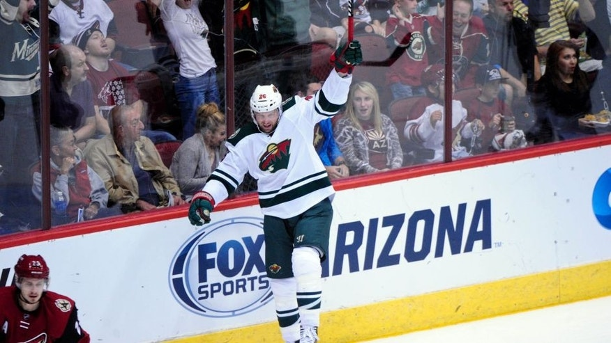 Oct 15, 2015; Glendale, AZ, USA; Minnesota Wild left wing Thomas Vanek (26) celebrates after scoring a goal in the first period against the Arizona Coyotes at Gila River Arena. Mandatory Credit: Matt Kartozian-USA TODAY Sports