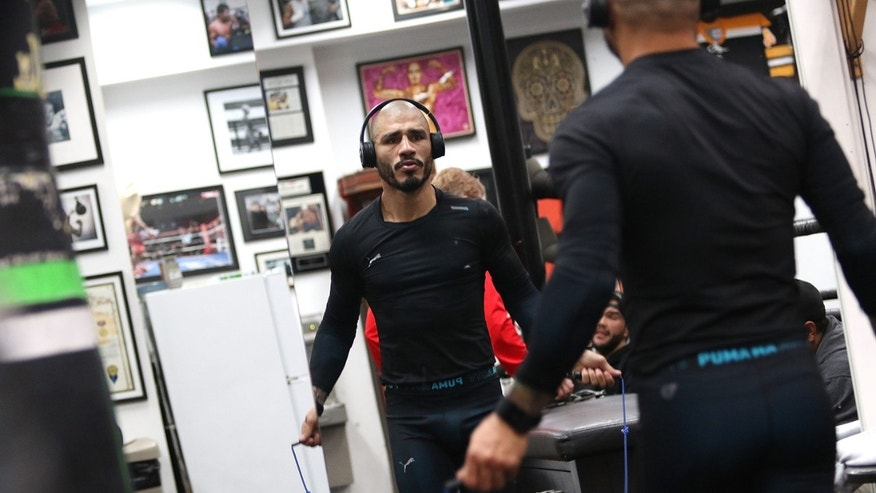 HOLLYWOOD, CA - NOVEMBER 11:  Professional Boxer Miguel Cotto trains with Fitbit Surge in preparation for his fight on Nov. 21 with Canelo Alvarez at Wild Card Boxing Club on November 11, 2015 in Hollywood, California.  (Photo by JC Olivera/Getty Images for fitbit)