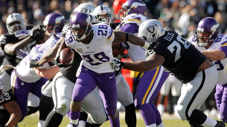 Nov 15, 2015; Oakland, CA, USA; Minnesota Vikings running back Adrian Peterson (28) runs the ball against the Oakland Raiders in the first quarter at O.co Coliseum. Mandatory Credit: Cary Edmondson-USA TODAY Sports
