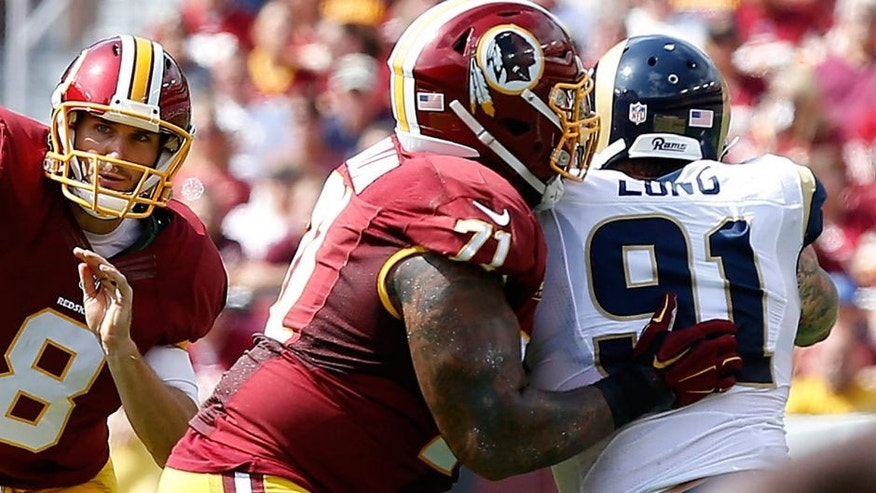 Sep 20, 2015; Landover, MD, USA; Washington Redskins quarterback Kirk Cousins (8) throws the ball as St. Louis Rams defensive end Chris Long (91) chases in the first quarter at FedEx Field. Mandatory Credit: Geoff Burke-USA TODAY Sports