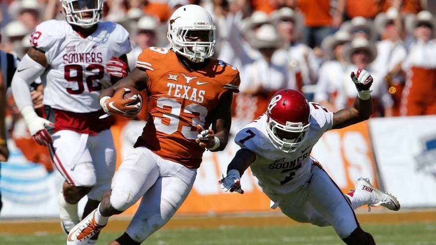Oct 10, 2015; Dallas, TX, USA; Texas Longhorns running back D'Onta Foreman (33) runs with the ball in the third quarter against Oklahoma Sooners cornerback Jordan Thomas (7) during Red River rivalry at Cotton Bowl Stadium. Mandatory Credit: Matthew Emmons-USA TODAY Sports